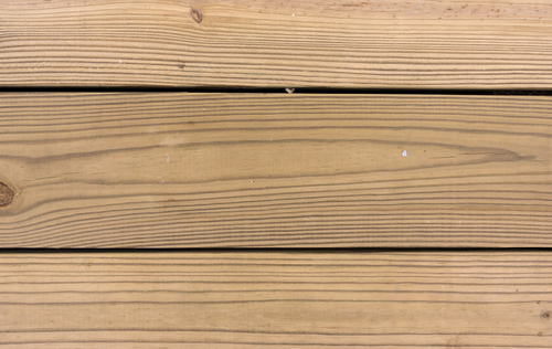 Pressure treated wood on the house for Brown treated deck boards