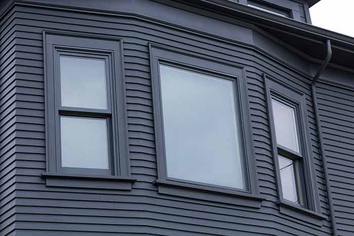 Sustainable synthetic siding on point with traditional for Synthetic wood siding